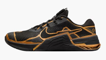 Nike Metcon 7 - Men's - Mat Fraser Edition - Black / Gold side view shown on a white background