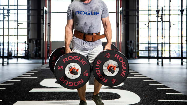 Rogue Farmers Walk Handles in use by Male athlete in Rogue HQ Gym